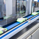 Automatic case packer for bags and pouches, Versapack by Quin Systems